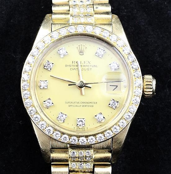 A lady's 1980's 18ct gold and after market diamond set Rolex Oyster Perpetual Datejust,
