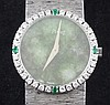 A lady's 18ct white gold Piaget manual wind wrist watch with diamond and emerald set bezel and jade dial,