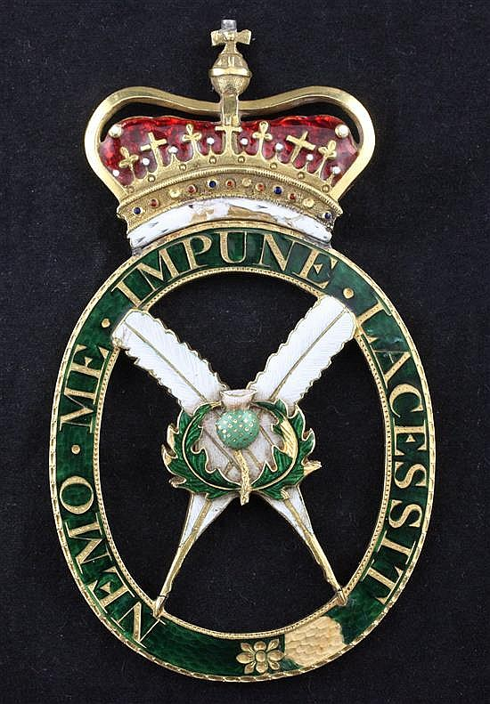 A rare enamelled gold neck badge of the Secretary of the Order of the Thistle