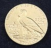 A United States 1911 $5 gold coin,