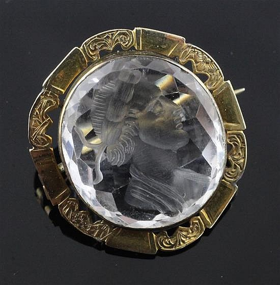 A 19th century engraved gold mounted intaglio rock crystal oval brooch, 29mm.