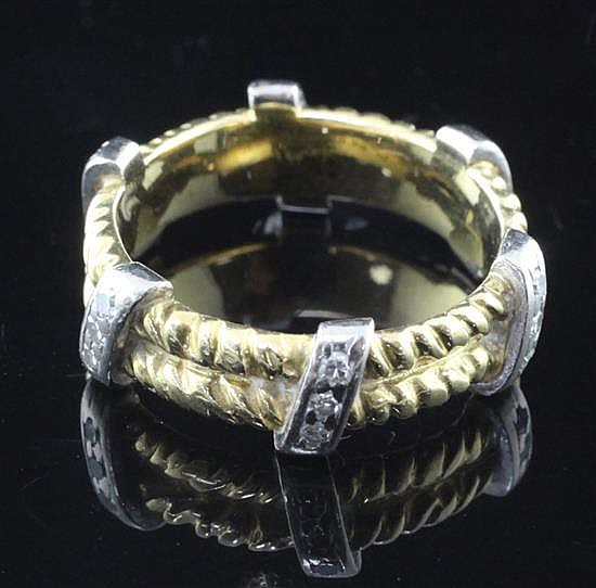 A late 1960's Kutchinsky 18ct gold and diamond double ropetwist band ring, size M.