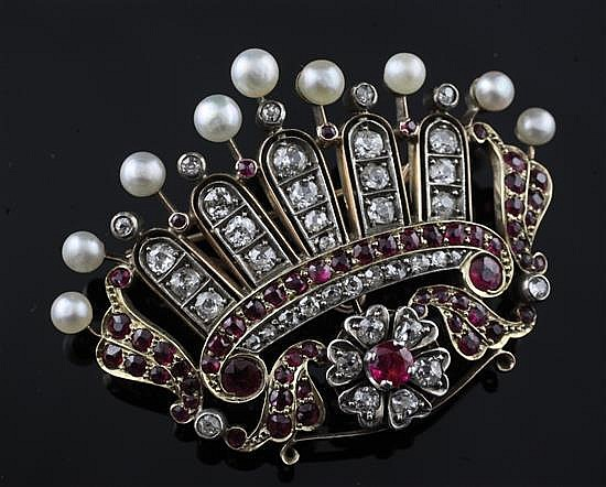 A late 19th/early 20th century gold, ruby, diamond and pearl coronet brooch, width 52mm.