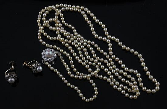A mid 20th century single strand cultured pearl necklace with diamond and pearl set white gold clasp & pr of earclips.
