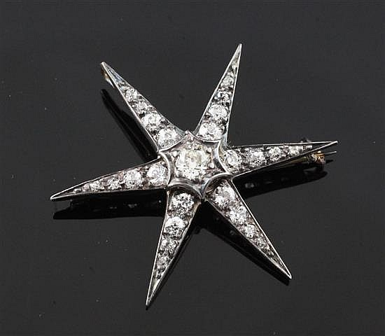 A Victorian gold, silver and graduated diamond star pendant brooch, 1.25in.
