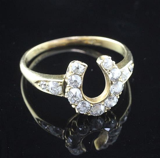 A late Victorian gold and diamond horseshoe ring, size P.