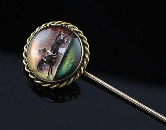 A late 19th/early 20th century French 18ct gold and Essex crystal stock pin decorated with a horse and jockey, 3in.