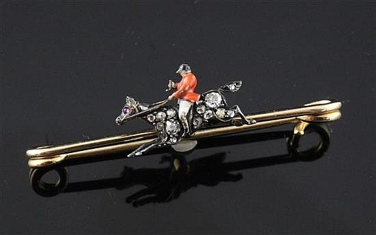 A late Victorian gold, enamel and diamond set bar brooch/stock pin modelled as a huntsman on his horse, 1.75in.