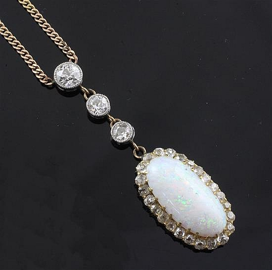 A gold, white opal and diamond drop pendant on a 9ct gold curb link chain, pendant drop approx. 2in.