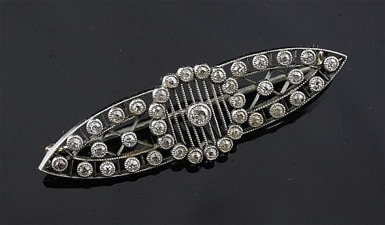 A Belle Epoque platinum, gold and millegrain set diamond openwork brooch, 1.75.