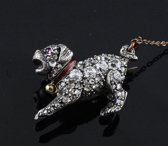 A late Victorian gold, silver and diamond pug dog brooch, 23mm.