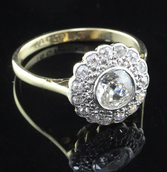 A 1930''s/1940''s 18ct gold, platinum and diamond cluster ring, size M.