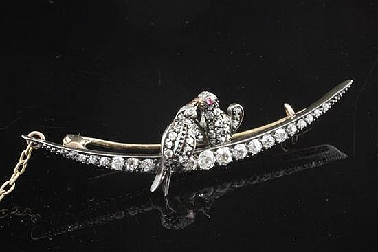 A Victorian gold and silver, old and rose cut diamond set crescent brooch surmounted with two birds, 2.25in.
