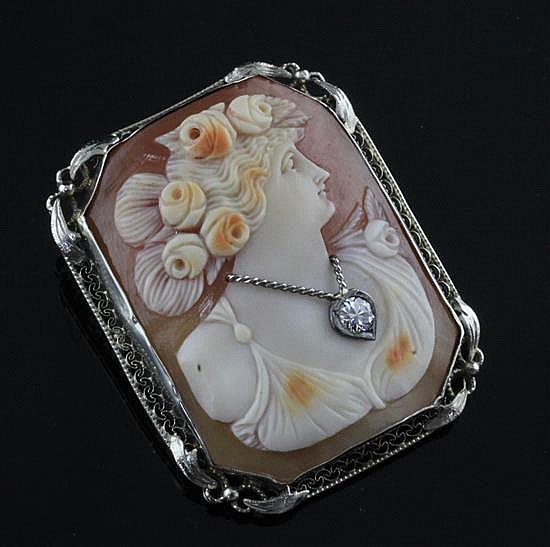 A 14ct gold mounted and diamond inset cameo brooch, 1.5in.