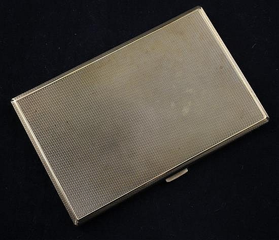 A 1940's engine turned 9ct gold cigarette case, 5in.