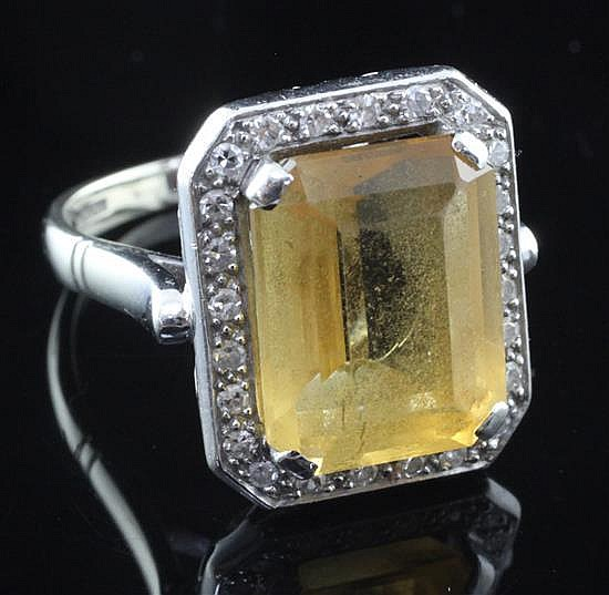 A modern 18ct white gold, citrine and diamond dress ring, size O.