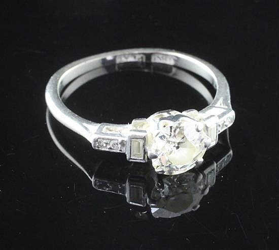 A 1920''s 18ct gold and platinum single stone diamond ring size M.