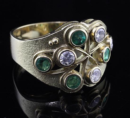 A Ray Smart (Guild of Sussex Craftsmen) modernist 18ct gold, diamond and emerald cocktail ring, size R.