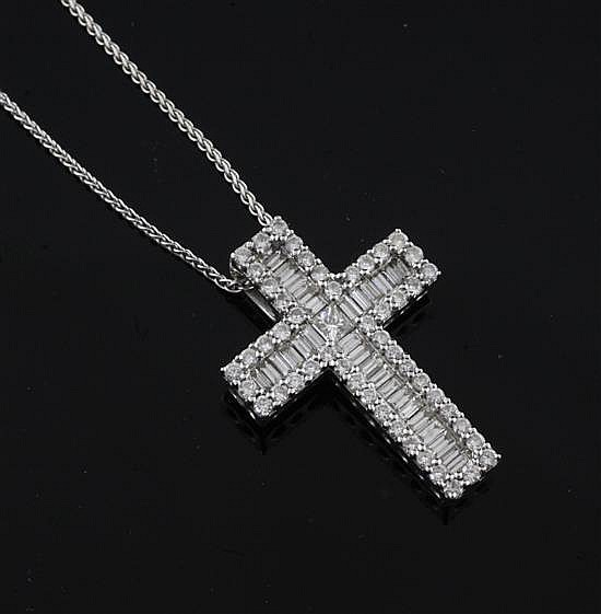 A modern 18ct white gold, baguette and round brilliant cut diamond set cross pendant, pendant 28mm.