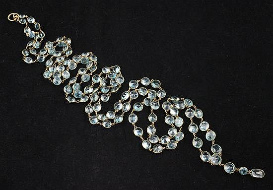 A gold and graduated blue zircon drop spectacle necklace, 46.5in.