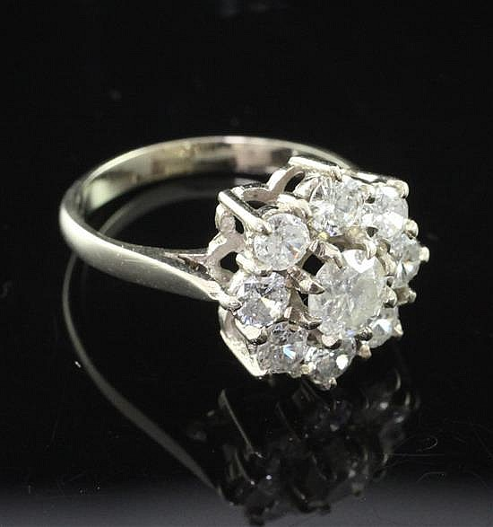 An 18ct white gold and diamond cluster ring, size N.