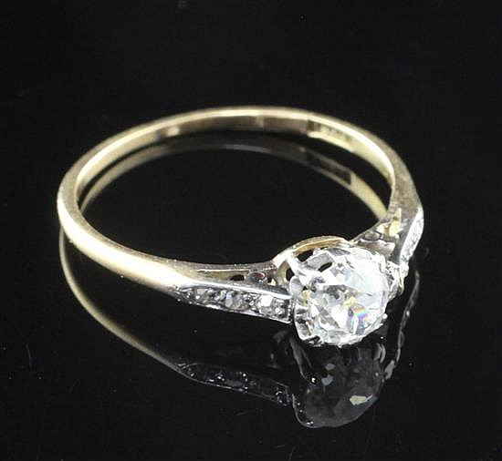 An early 20th century 18ct gold single stone diamond ring, size N.