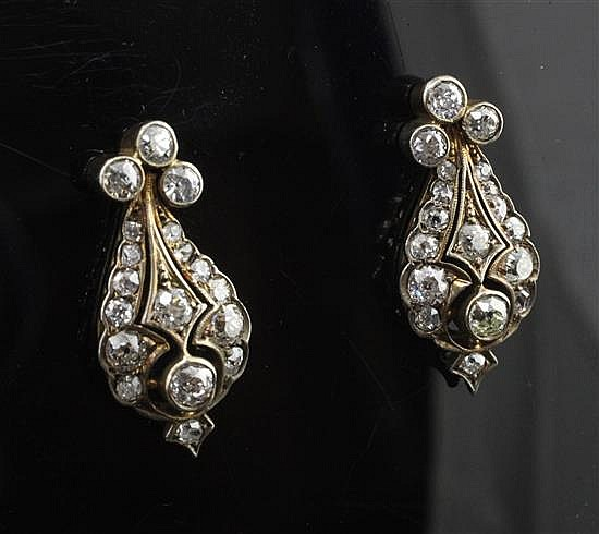 A pair of late 19th century gold, silver and diamond pear shaped earrings, 1in.