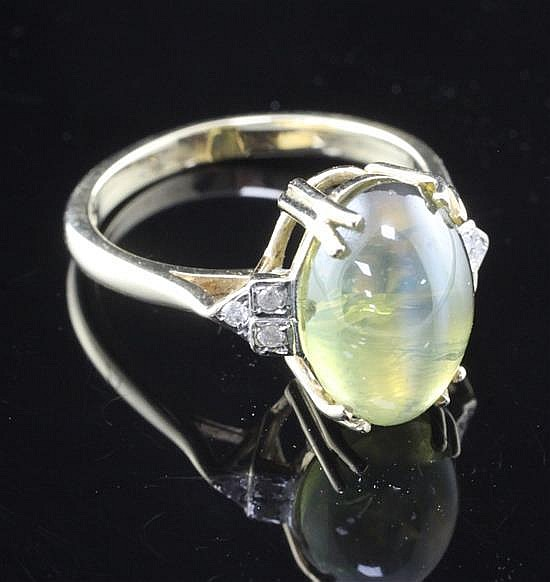 A 9ct gold, cat's eye chrysoberyl and diamond ring, size O.