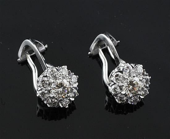 A pair of 18ct white gold and diamond cluster ear clips, diameter 10mm.
