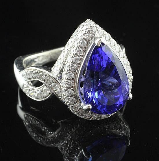 A 14ct white gold diamond and tanzanite dress ring, by Kallati, size O.
