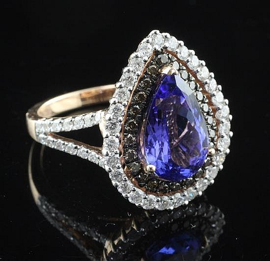 A 14ct gold, tanzanite and two colour diamond dress ring, by Kallati, size O.