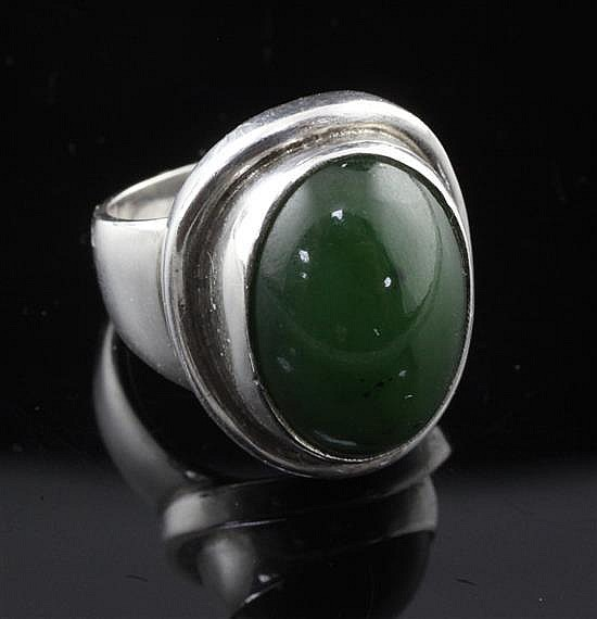 A George Jensen sterling silver and nephrite ring, no. 46A, size M.