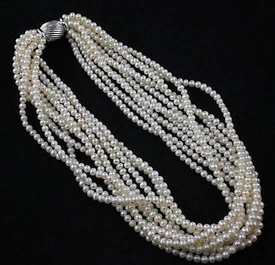 A modern multi-strand cultured pearl necklace with 14ct white gold fluted clasp, 17in.
