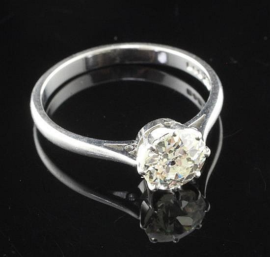 A platinum and solitaire diamond ring, size O.