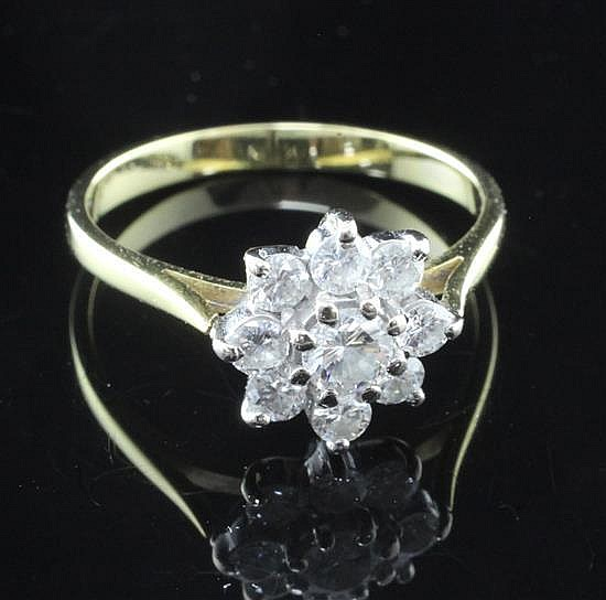 An 18ct gold and diamond cluster ring, size M.