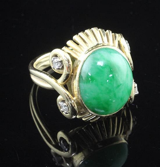 A 1950's Boucheron 18ct gold, cabochon jadeite and diamond oval dress ring, size L.