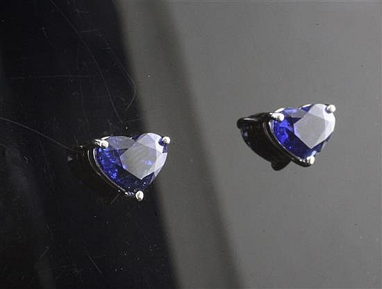An attractive pair of 18ct white gold and heart shaped sapphire ear studs,