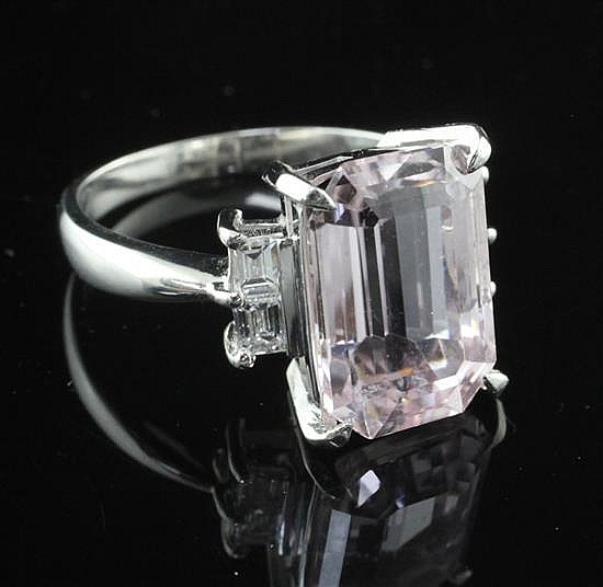 A 900 platinum, emerald cut kunzite and diamond set dress ring, size O.