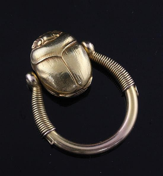 An early 20th century 14k gold swivelling Scarab locket ring, size N.