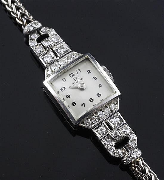 A lady's 1940's platinum and diamond set Omega manual wind cocktail watch, in Mappin & Webb box.