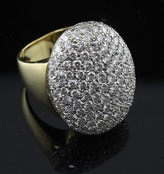 A modern 18ct gold and pave set diamond oval dress ring, size O.