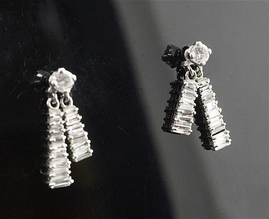 A pair of white gold and diamond double tassel drop earrings, 19mm.