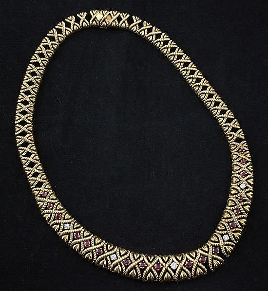 An 18ct gold, ruby and diamond articulated necklace, approx. 16in.