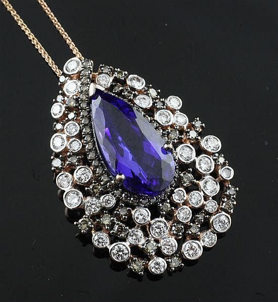 A 14ct gold, tanzanite and two colour diamond teardrop shaped pendant by Kallati, on a 14ct gold fine link chain, chain 18in.