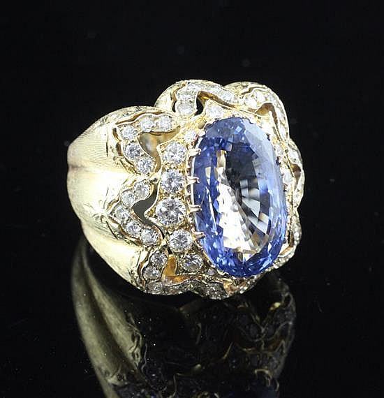 A fine textured 18ct gold, Ceylon sapphire and diamond dress ring by Mario Buccellati, Milan, size N.