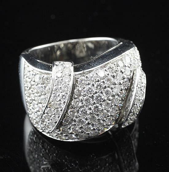 A modern 18ct white gold and pave set diamond dress ring, size L.