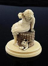 A 19th century carved ivory figure of a girl playing with a cat, 2.75in.