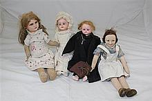 An early 20th century composition doll and three other dolls
