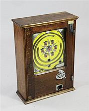 An oak cased Penny Arcade game, numbered 591, c.1950, 18.5in.