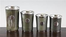 A graduated set of four Austrian horn and silver plated beakers, largest 4.5in.